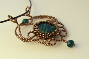 Handmade pendant made of golden beads and chrysocolla stone