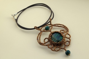 Large pendant with chrysocolla centerpiece, golden beads and brown leather