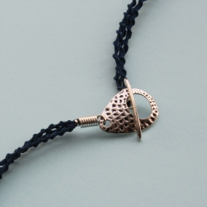 Necklace fastens with a toggle clasp