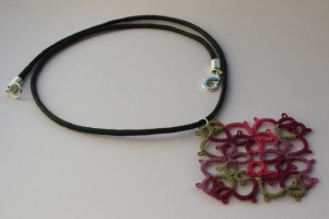 Flavour - handmade lace pendant on a black string necklace
