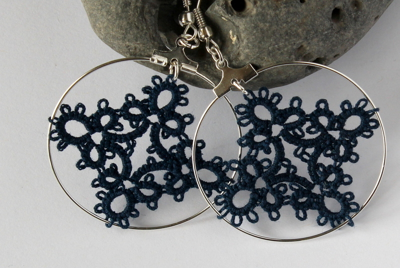 Handcrafted lace navy earrings on a wire