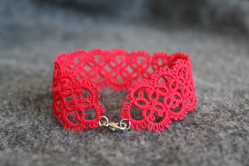 Red handmade bracelet with lobster clasp.