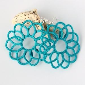 Teal hand-made earrings.