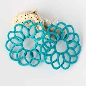 Teal hand-made earrings.